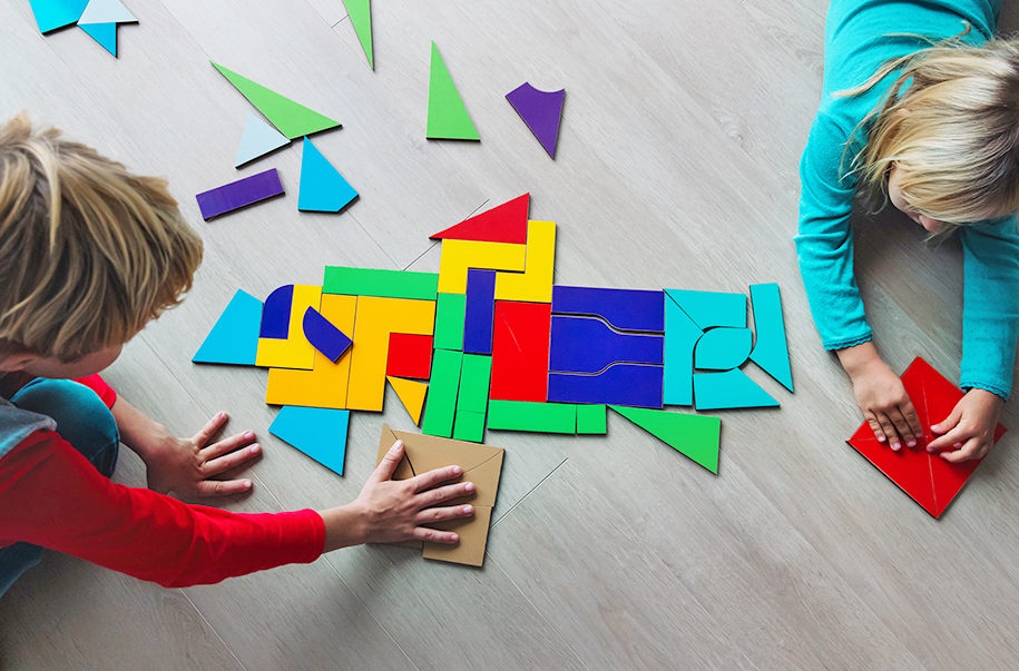 Children Putting Together Puzzle